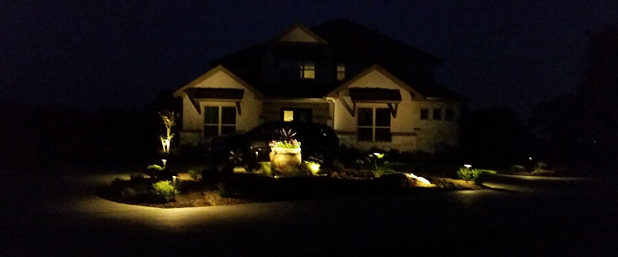 Soft lighting creates a welcoming scene - Paradise Landscape Lighting Designs New Braunfels